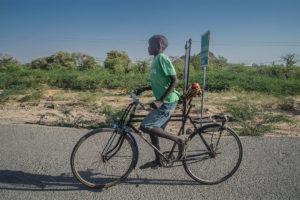 A-young-boy-in-Lodwar-kenya-riding-a-bicycle-through-the-Scotching-sun