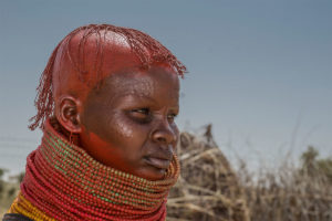 Turkana-lady-showcasing-her-neck-gear-and-her-pierced-face-that-symbolises-right-of-passage-in-the-Northern-kenyan-based-tribe-during-an-Annual-festival-named-Tubong-lore